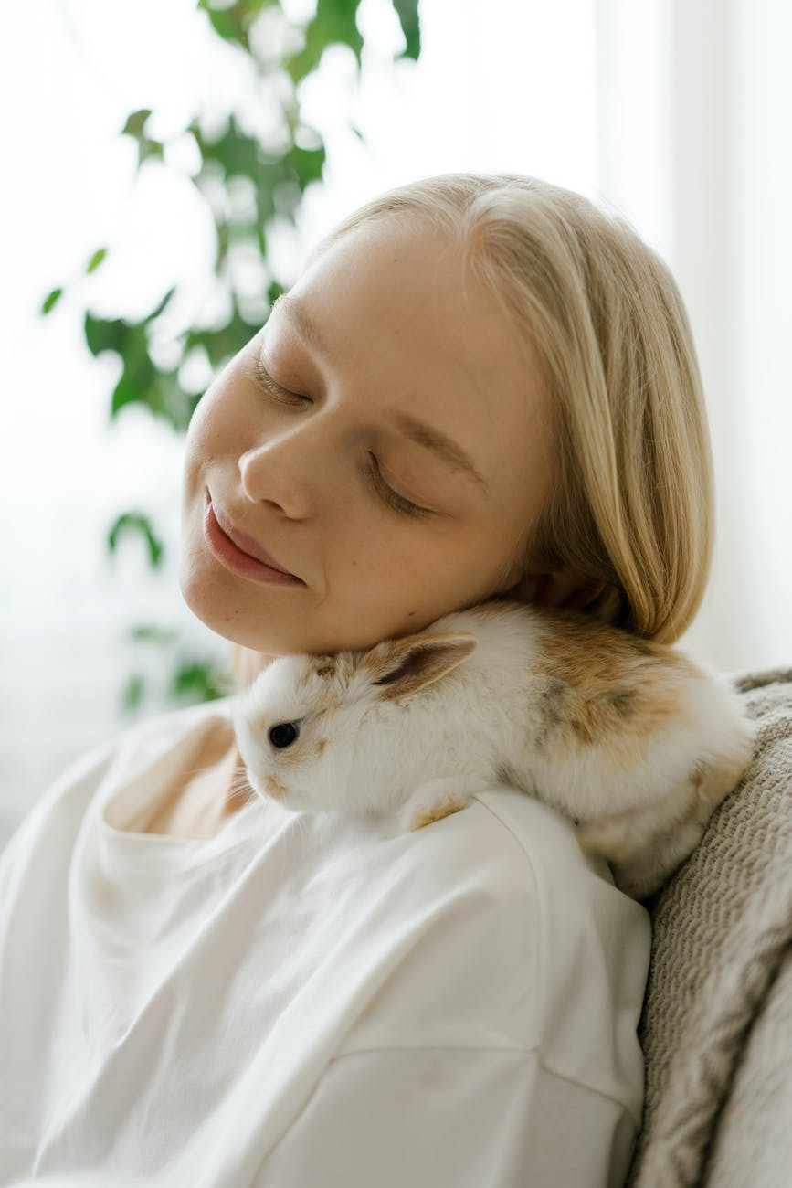 peaceful woman cuddling with bunny